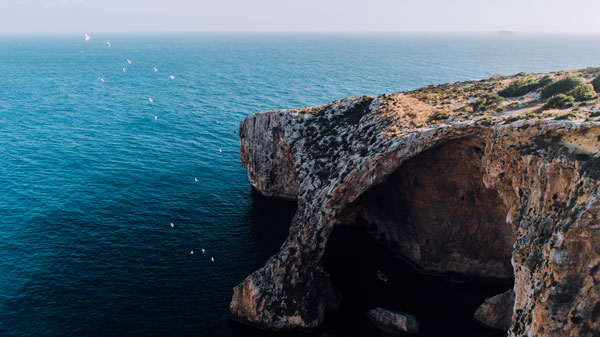 Aerial-of-Blue-Grotto,-Malta